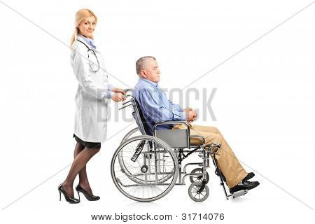 Full length portrait of a nurse or doctor pushing a handicapped senior man in a wheelchair isolated on white background