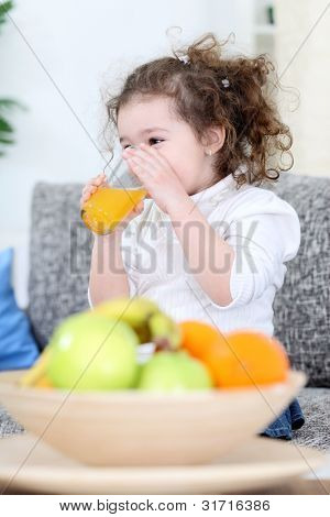 trusty little girl drinking fresh juice