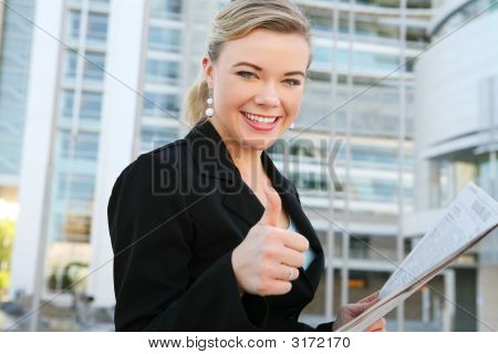 Pretty Business Woman With Thumbs Up