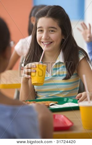 Four girls eating lunch in cafeteria