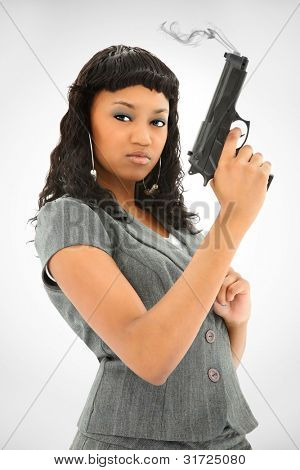 Attractive Black Female Holding Smoking Handgun While Looking At The Camera