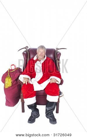 Humorous closeup of Santa Claus (that jolly old elf that  lives at the North Pole) resting after a hard nights work