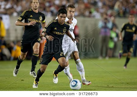 LOS ANGELES - JULY 16: Real Madrid C.F. M Jese #28 & Los Angeles Galaxy D A.J. DeLaGarza #20 during the World Football Challenge game on July 16 2011 at the Los Angeles Memorial Coliseum.
