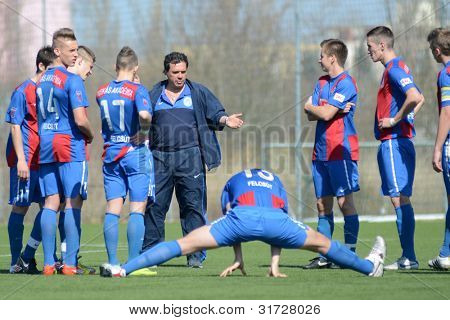 KAPOSVAR, HUNGARY - MARCH 17: Videoton players listening to trainer at the Hungarian Championship under 18 game between Kaposvar (white) and Videoton (blue), March 17, 2012 in Kaposvar, Hungary.