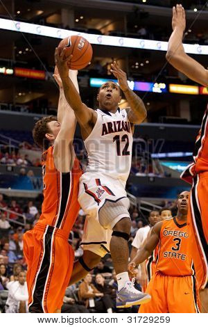 LOS ANGELES - MARCH 10: Arizona Wildcats G Lamont Jones #12 drives to the basket and lays the ball up during the NCAA Pac-10 Tournament basketball game on March 10 2011 at Staples Center.