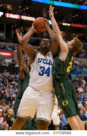 LOS ANGELES - MARCH 10: UCLA Bruins C Joshua Smith #34 &  Oregon Ducks forward E.J. Singler #25 during the NCAA Pac-10 Tournament basketball game on March 10 2011 at Staples Center.