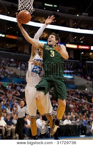 LOS ANGELES - MARCH 10: Oregon Ducks G Garrett Sim #3  & UCLA Bruins F Tyler Honeycutt #23 during the NCAA Pac-10 Tournament basketball game on March 10 2011 at Staples Center.
