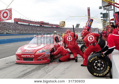 FONTANA, CA. - MARCH 27: Juan Pablo Montoya in the #42 Target Chevrolet pits during the NASCAR Sprint Cup Series Auto Club 400 on March 27 2011 at Auto Club Speedway.
