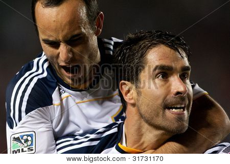 CARSON, CA. - MAY 14: Los Angeles Galaxy F Landon Donovan #10 (L) & Los Angeles Galaxy F Juan Pablo Angel #9 (R) celebrate a goal during the MLS game on May 14 2011 at the Home Depot Center.