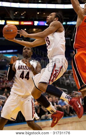 LOS ANGELES - MARCH 10: Arizona Wildcats F Jesse Perry #33 lays the ball up during the NCAA Pac-10 Tournament basketball game on March 10 2011 at Staples Center in Los Angeles.