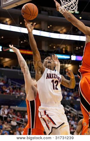 LOS ANGELES - MARCH 10: Arizona Wildcats G Lamont Jones #12 drives to the basket and lays the ball up during the NCAA Pac-10 Tournament basketball game on March 10 2011 at Staples Center