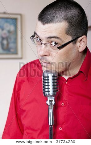 Funny man with old retro microphone