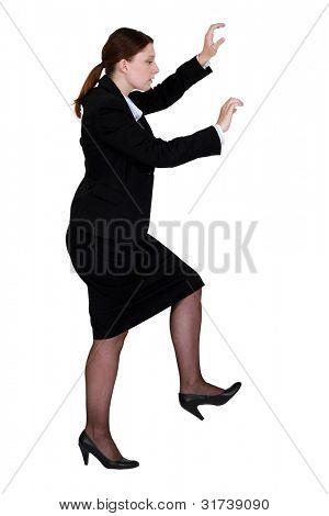 Woman pretending to climb