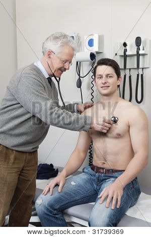 Portrait of young patient getting his medical checkup done by a doctor