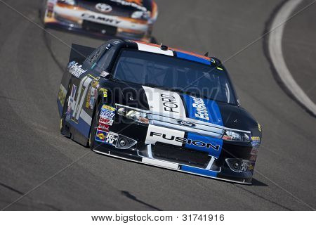 FONTANA, CA - MARCH 23: Matt Kenseth (17) brings his race car through turn 4 during a practice session for the Auto Club 400 race at the Auto Club Speedway in Fontana, CA on March 23, 2012.