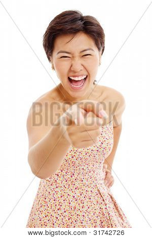 Beautiful asian girl showing forefinger on something and laughing very much. Isolated on white background, mask included