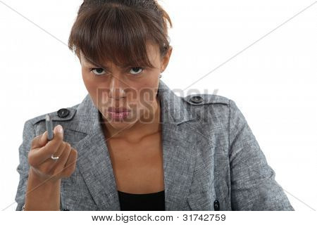 Angry businesswoman pointing with pen