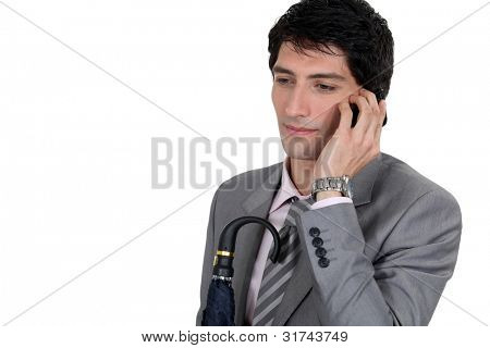 Weary businessman talking on his mobile phone