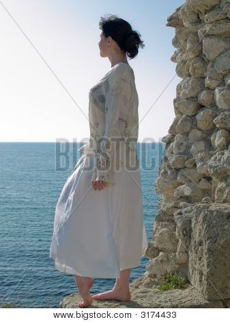 Lonely Young Woman Looks On Sea