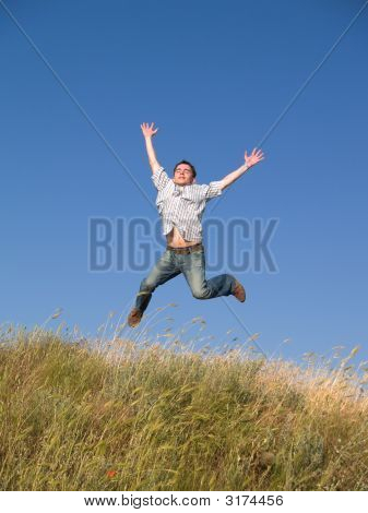 Happy Jumping Teenager Above Hill