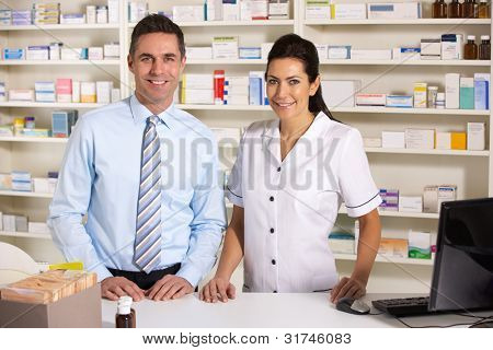 UK nurse and pharmacist working in pharmacy