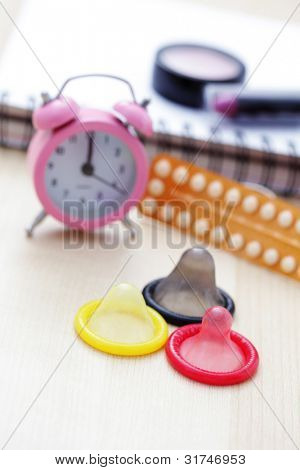birth control pill with condom - healthcare and medicine