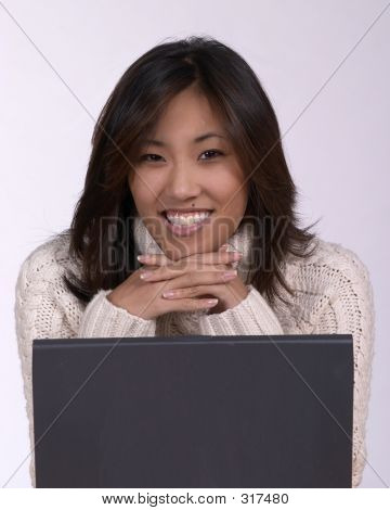 Smiling Asian Woman At Computer