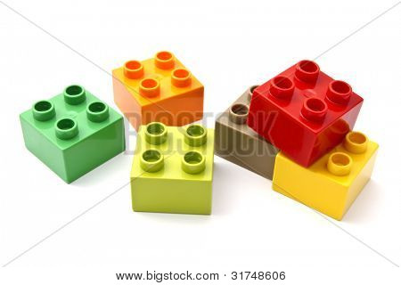 Colorful building blocks closeup on white background