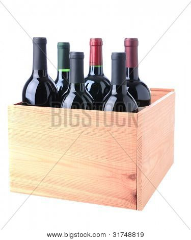 An assortment of Red Wine bottles standing in a wooden crate isolated on a white background.