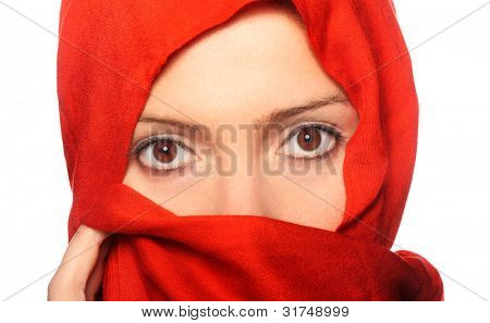 A picture of a young muslim woman in a red scarf over white background
