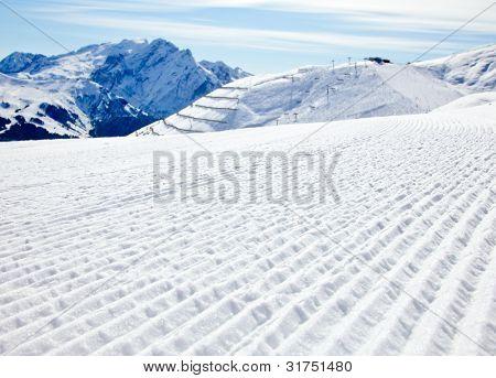 Fresh snow on a ski slope at Val Di Fassa ski resort in Italy