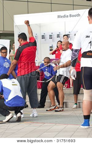 TOA PAYOH, SINGAPORE - MARCH 24 : Contender for Strongman Sulaiman Ismail in the Mazda CX-7 car pull category in the Strongman Challenge 2012 on March 24, in Toa Payoh Hub, Singapore.