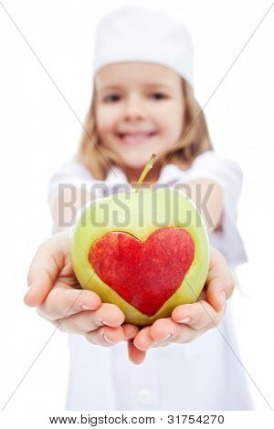 Little girl dressed as nurse giving you an apple with heart - healthy life concept