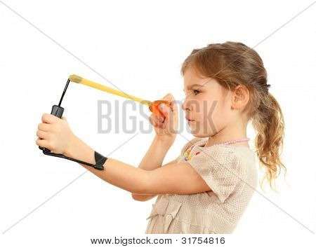 Concentrated girl with slingshot aim isolated on white background