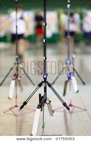 Three big sport bows stand on stilts inside shooting gallery
