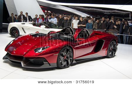 GENEVA SWITZERLAND - MARCH 12: The Lamborghini Stand displaying a full view of the lamborghini aventador convertible in RED, at the Geneva Motorshow on March 12th, 2012 in Geneva, Switzerland.