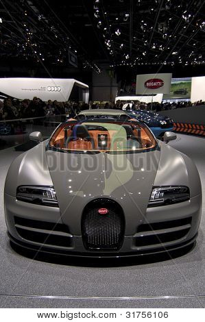 GENEVA SWITZERLAND - MARCH 12: The Bugatti Stand displaying a full frontal view of the Veyron convertible in MATT Gunmetal grey, at the Geneva Motorshow on March 12th, 2012 in Geneva, Switzerland.