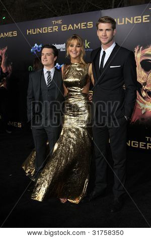 LOS ANGELES, CA - MAR 12: Josh Hutcherson, Jennifer Lawrence, Liam Hemsworth at the premiere of Lionsgate's 'The Hunger Games' at Nokia Theater L.A. Live on March 12, 2012 in Los Angeles, California