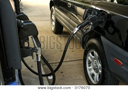 Fueling Black Car At The Gas Station