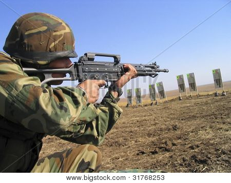 Real Camouflaged Soldier Aiming.