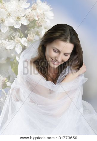 sitting beauty bride in white dress looks down isolated on floral background