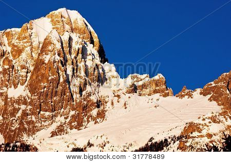 Sunset view of a mountain full of snow