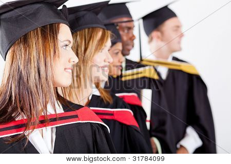 group of graduates looking away at graduation