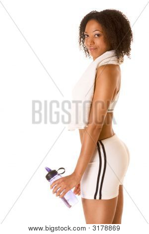 Fit Female With Bottle Of Water And Towel