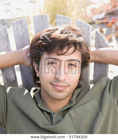 Close up of Hispanic man in beach chair