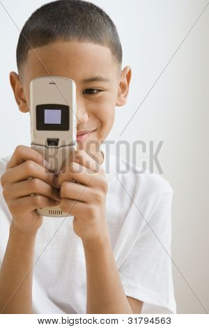 Indian boy looking at cell phone