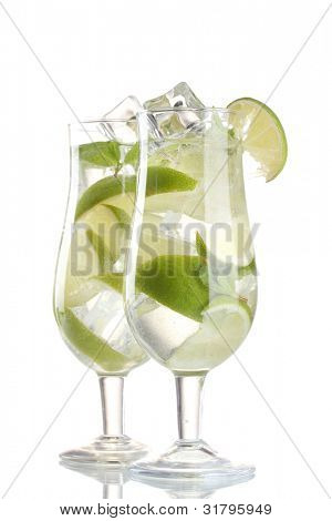 glasses of cocktail with lime and mint isolated on white
