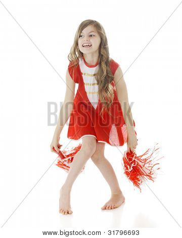 A pretty elementary girl cheer leading in her red and white outfit and pompoms. motion blur on pompoms.  On a white background.