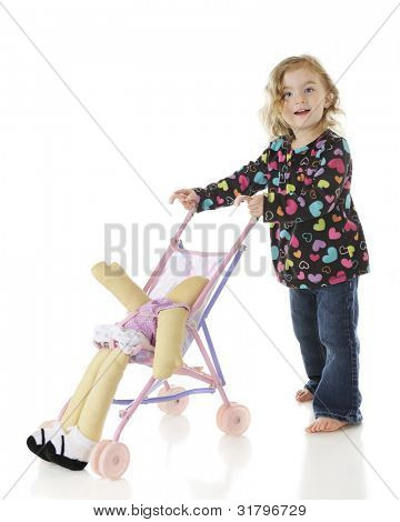 An adorable preschooler pushing her doll yin an umbrella stroller, but the doll is slipping out.  On a white background.