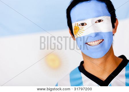 Portrait of a man with an Argentinean flag painted on his face